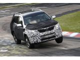 Kia Sorento facelift spied up on two wheels at Nurburgring