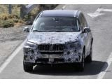 foto-galeri-2014-bmw-x5-spied-with-less-camouflage-14207.htm