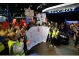 Paris police fired tear gas at a PSA Peugeot Citroen group of workers -