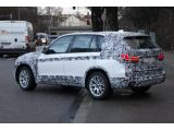 foto-galeri-2014-bmw-x5-spied-wearing-less-camo-16872.htm