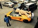 DMC Lamborghini Aventador photographed with a giant teddy bear on the ro