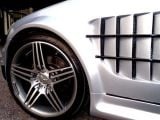 custom SLR fenders, 18'AMG wheels and matte silver finish really br
