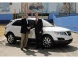 First Saab 9-4X rolls off production line, J Chess (left) and Jan Åke Jo