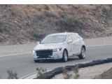 foto-galeri-2012-volvo-v30-spied-with-less-camo-7840.htm